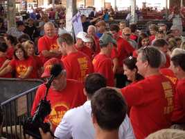 """Along with plenty of support. """"Bring home the bacon"""" can be seen on the back of the red shirts."""