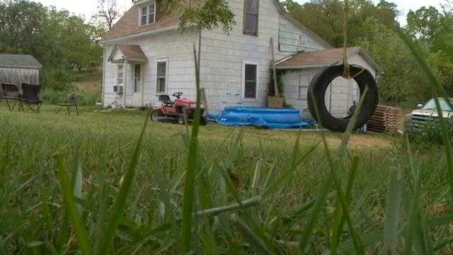 A Leon mother and her three small children were held at gunpoint in their home Friday night.
