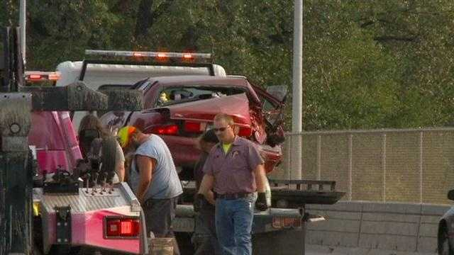 Police: Truck slams into disabled car