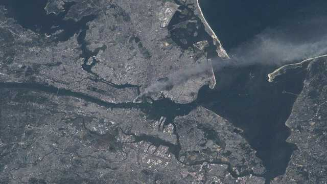 Visible from space, a smoke plume rises from the Manhattan area after two planes crashed into the towers of the World Trade Center.