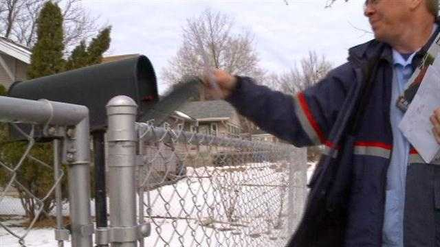 Postal worker delivers mail