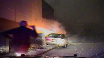 Officer arrives at scene to find car on fire, next to the church.