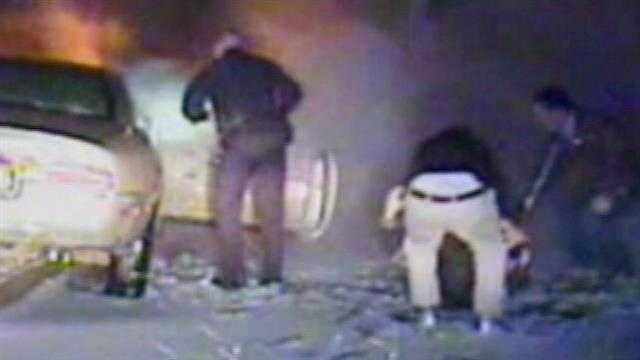 Urbandale police said an officer pulled an unconscious driver from a burning car Sunday night.