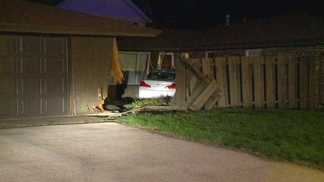 Car slams into garage, through fence and into house