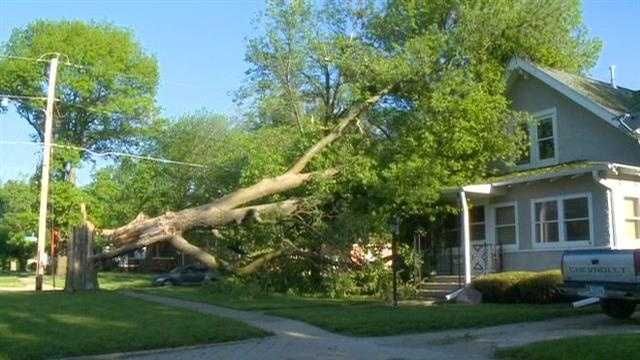 Iowans clean up damage from severe storms Sunday night.