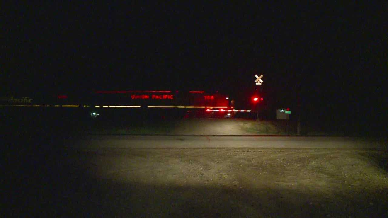 Driver killed in crash with train