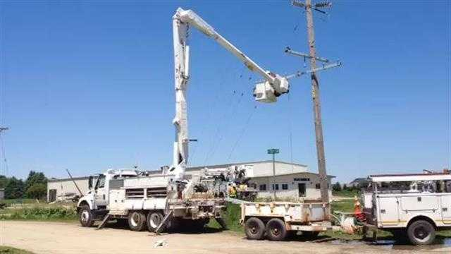 Utility crews work to clean up damage in Belmond following a tornado Wednesday night.