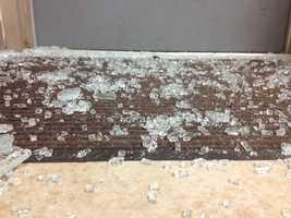 Broken glass still covers the floor.