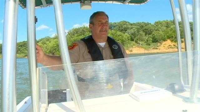 DNR Officer in boat on Saylorville Lake