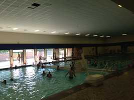 RAGBRAI in Perry.  Riders cool off in city's pool.