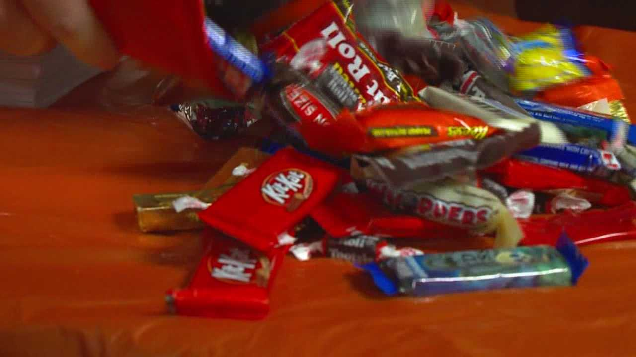Kids trade Halloween candy for cash, good cause