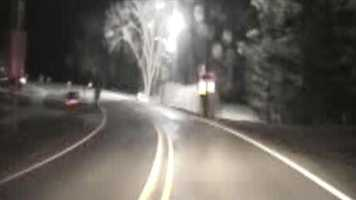 The truck hits a transformer that explodes in a small fireball as it slides off the roadway.