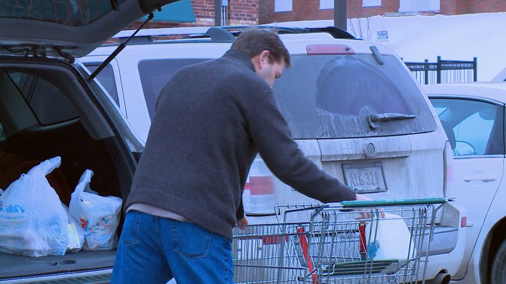 Customers flood grocers, hardware stores before wintery blast