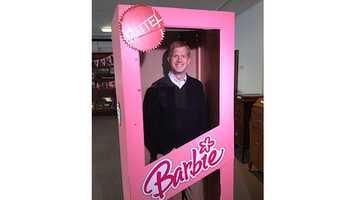 Eric Hanson inside a giant Barbie box.