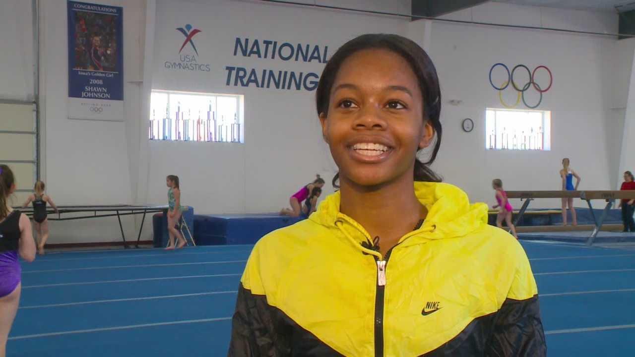 Gabby Douglas returns to training in Iowa