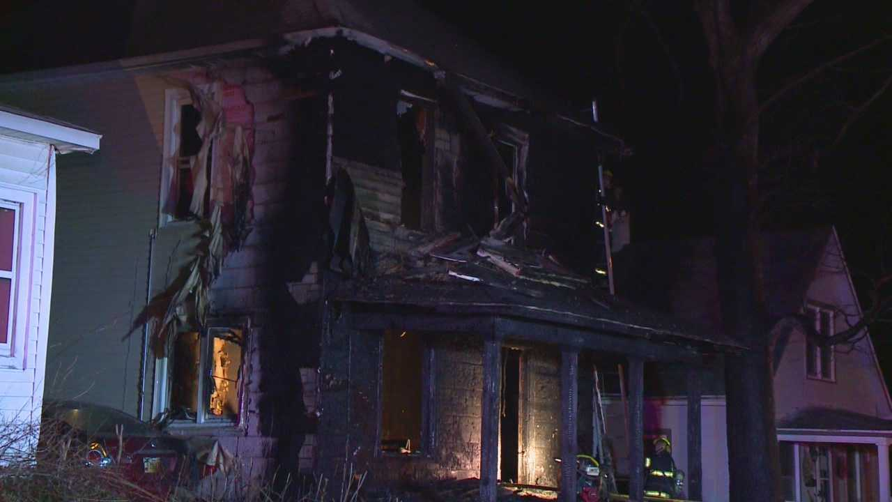 Three people are lucky to be alive after two homes caught fire early Tuesday morning.