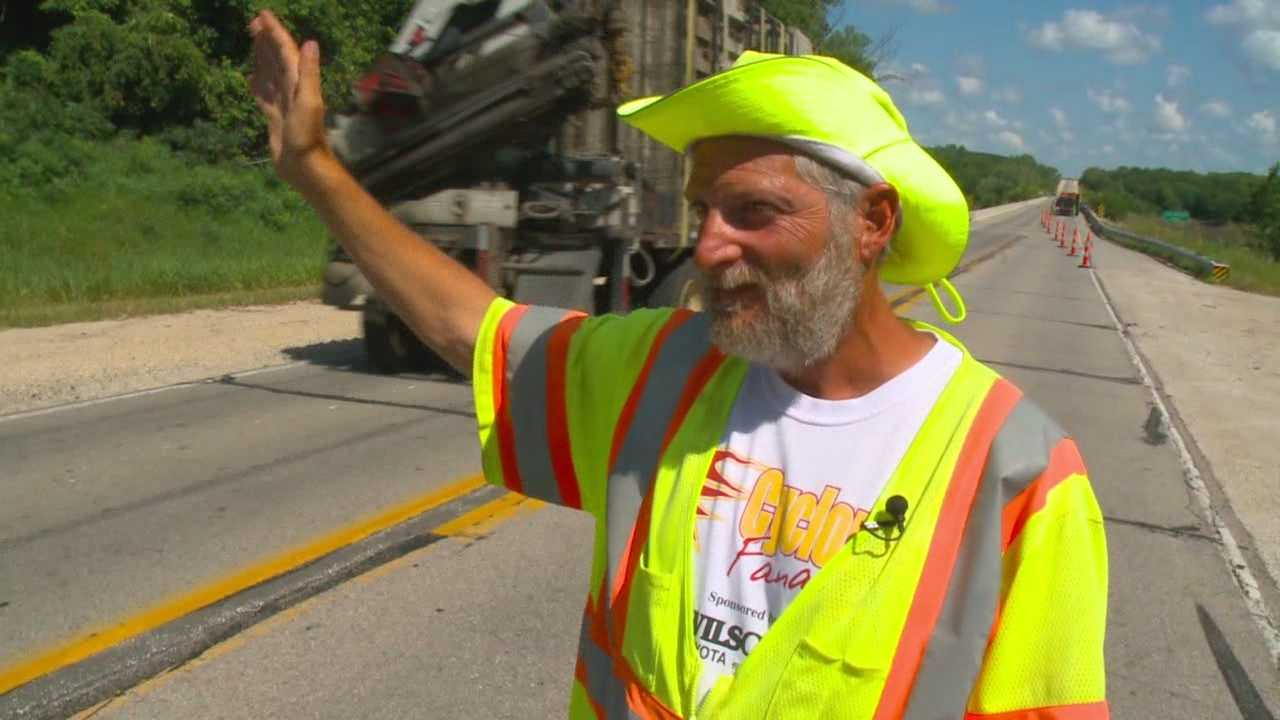 this is iowa waving construction worker