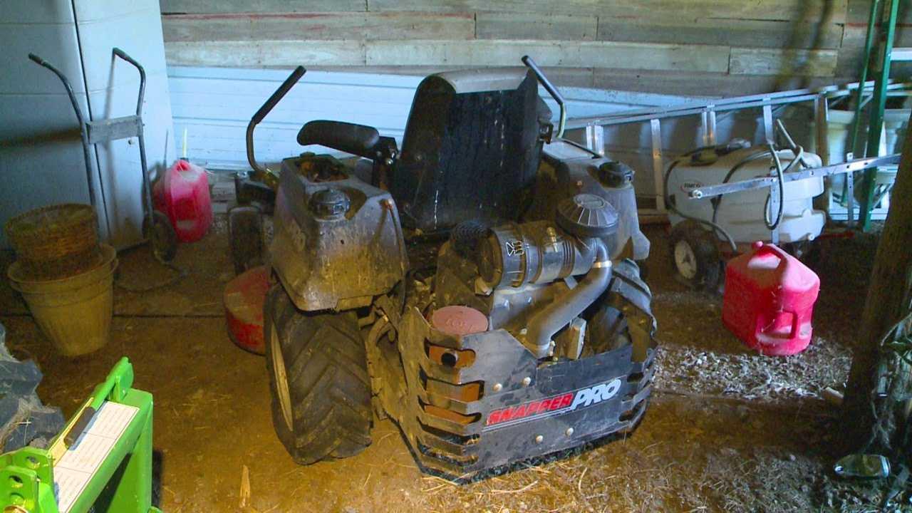 700-pound lawn mower pins man