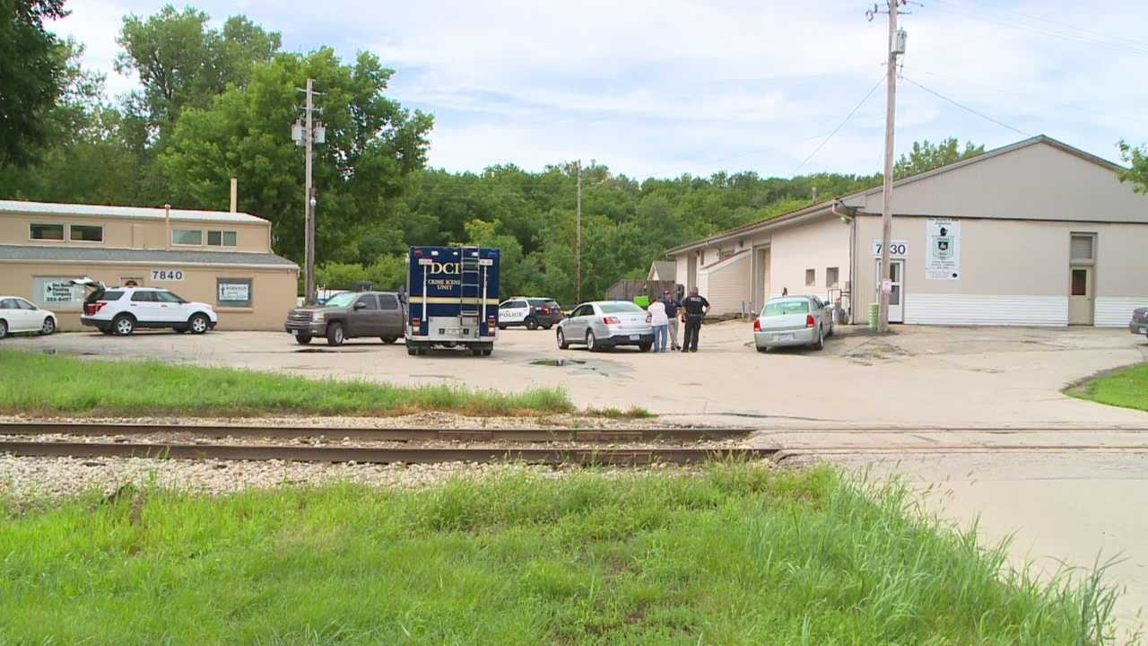 Police have identified the body found Saturday morning behind a Clive business.