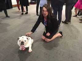 KCCI's Rose Heaphy meets Griff, Drake University's mascot before the debate.