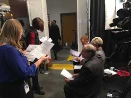 KCCI's Stacey Horst and Steve Karlin prepare for coverage before the debate.