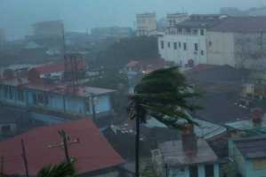 The high winds of Hurricane Matthew roar over Baracoa, Cuba, Tuesday, Oct. 4, 2016. The dangerous Category 4 storm blew ashore in Haiti, unloading heavy rain as it swirled on toward a lightly populated part of Cuba and the Bahamas.