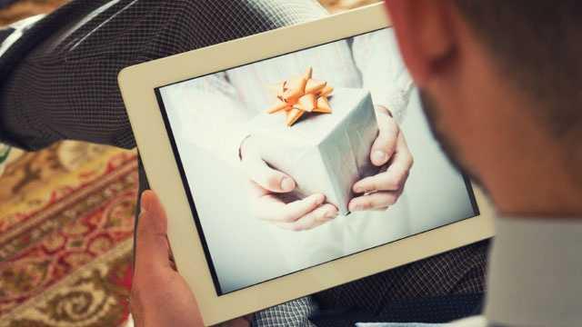 Christmas gift on digital tablet