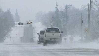 Snow Blowing Across Road