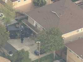 Noon -- Multiple SWAT teams surround the building&#x3B; shooting suspect is barricaded inside.
