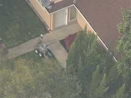 5:10 p.m. -- Flash bombs shoot off, robots move onto lawn toward barricaded apartment.
