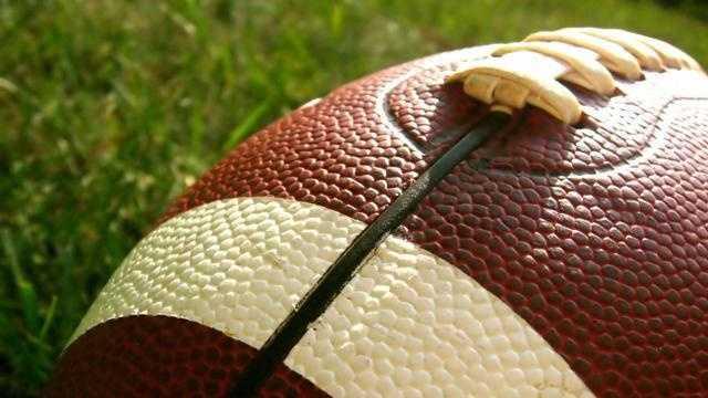 Football On Grassy Field NFL - 14927824