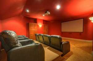 Here it is. This home boasts a theater with surround sound -- and appropriate seating.