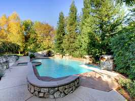 Here's a look at the home's sparkling pool, including waterfalls.