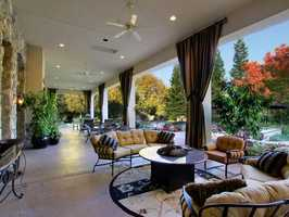 The home has this covered patio -- perfect for lounging around.