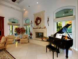 The black baby grand piano accents this room.