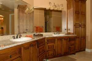 Here's a look inside the bathroom, which has floor-to-ceiling cabinetry.