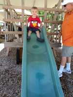 Tanner from South Sacramento prepares to go down a slide.