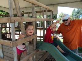 Charlotte and Tanner play on a play structure while at Ag Ventureland.