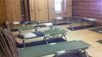 2:38 p.m. ThursdayEmpty cots sit at a shelter in Foresthill. Red Cross says five evacuees currently registered. About 20 more are in cars outside.