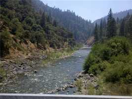 Noon ThursdayReports are dismissed that the fire had jumped the American River.