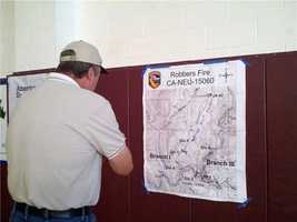 7:20 p.m.Foresthill residents gather and view Robbers Fire map.