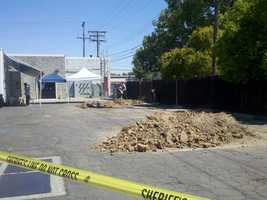 Thursday - Mounds of dirt pile up as authorities continue their search.