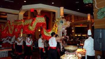 Dragon dancers make their way through therestaurant.