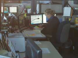 ThursdayA dispatcher is at work inside an operation center in Redding.