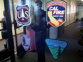 ThursdayPersonnel are busy inside a Cal Fire operation center in Redding.