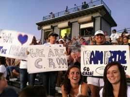 Some Casa Roble moms in the stands cheer on their team.