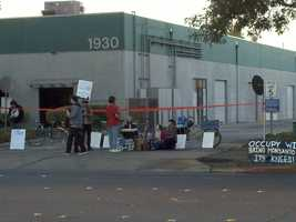 On Monday morning, about 100 Occupyprotestersblocked off the parking lot to Monsanto Corporation on 5th Street in Davis.