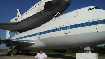 Bob Coyne in front of Endeavour at the Shuttle Landing Facility.