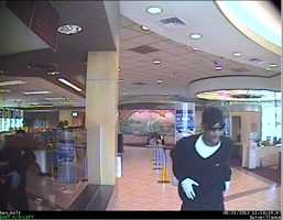 Police said the two men armed with guns walked into the Premier Community Credit Union in the 3200 block of West Ben Holt Drive at 11:18 a.m.
