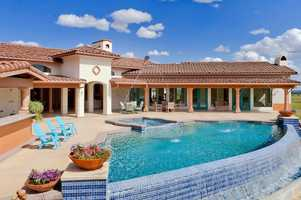 This home has this infinite edge, salt water pool and spa with fountain jets.